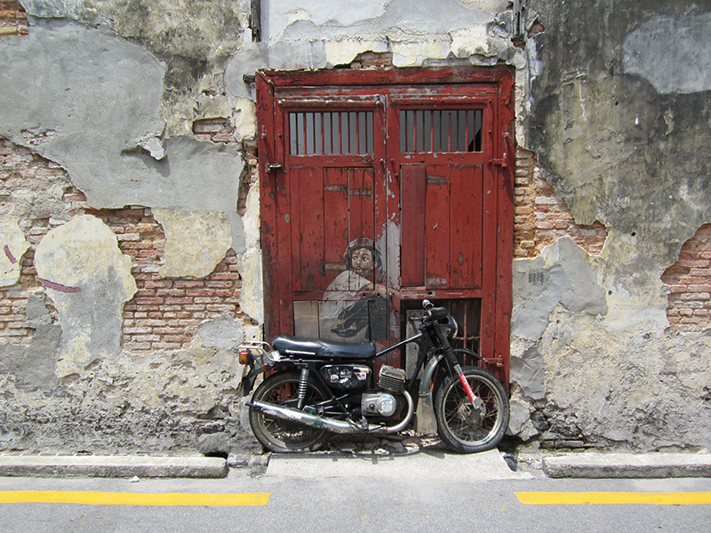 The Boy on a Bike mural by Ernest Zacharevic. Photo: Chris Ashton